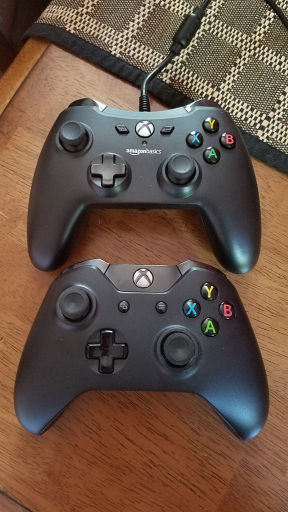 Photo of an AmazonBasics controller above an Xbox One Controller.